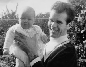 Kim as a baby with Dad